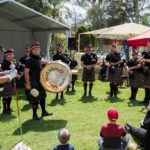 The crowd enjoys the Hills District Pipe Band